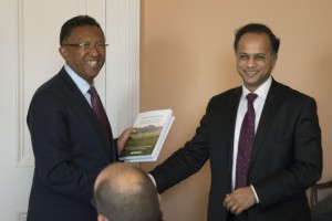 The President of Madagascar, Hery Rajaonarimampianina, receives a copy of Forests and Food from Bhaskar Vira (courtesy Cambridge Conservation Initiative)
